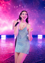 Dua Lipa looked fab in a blue crystal mini dress by Atelier Versace while performing at the 2020 American Music Awards.