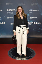 Drew Barrymore layered a cropped jacket over a lace-trimmed top for the 2020 Breakthrough Prize.