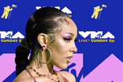 Doja Cat teamed a gemstone stud with her oversized hoops when she attended the 2020 MTV VMAs.