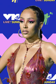 Doja Cat pulled her hair back into a tight braid for the 2020 MTV VMAs.