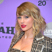 Taylor Swift sealed off her beauty look with a swipe of bright red lipstick.