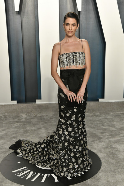 A flowing black skirt with silver floral embellishments polished off Nikki Reed's look.