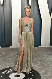 Nicky Hilton Rothschild looked radiant in a pleated gold gown by Oscar de la Renta at the 2020 Vanity Fair Oscar party.
