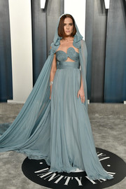 Zoey Deutch stole the spotlight in a caped blue cutout gown by Valentino Couture at the 2020 Vanity Fair Oscar party.
