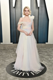 Lucy Boynton looked like a princess in a multi-pastel off-one-shoulder ballgown by Miu Miu at the 2020 Vanity Fair Oscar party.