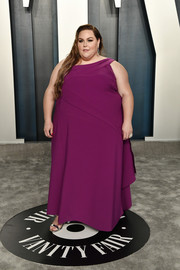 Chrissy Metz chose a purple one-shoulder gown for the 2020 Vanity Fair Oscar party.