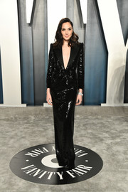 Gal Gadot looked impeccable in a black sequined tuxedo gown by Saint Laurent at the 2020 Vanity Fair Oscar party.