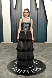 Rachel Brosnahan dolled up in a tiered, beaded black gown by Dolce & Gabbana for the 2020 Vanity Fair Oscar party.