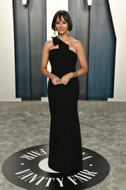 Rashida Jones went for minimalist elegance in a black one-shoulder column dress by Roland Mouret at the 2020 Vanity Fair Oscar party.