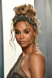 Ciara looked gorgeous wearing this loose top bun at the 2020 Vanity Fair Oscar party.
