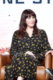 Liv Tyler attended the 2020 Winter TCA Tour wearing a black and yellow floral shirtdress.