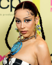 Doja Cat rounded out her fab look with a pair of feathered earrings by Jacob & Co.