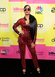 Her was sporty-glam in a red and black paillette jumpsuit by Dior at the 2021 Billboard Music Awards.