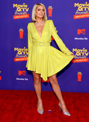 Paris Hilton couldn't be missed in her bright yellow Phillipp Plein wrap dress at the 2021 MTV Movie & TV Awards: UNSCRIPTED.