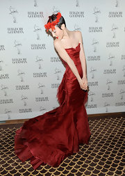 Michelle Harper wore a blood red evening gown with a gorgeous mermaid train to the Christian Louboutin celebration.