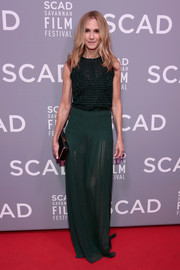 Holly Hunter attended the SCAD Savannah Film Festival screening of 'Molly's Game' wearing a green basketweave tank top.
