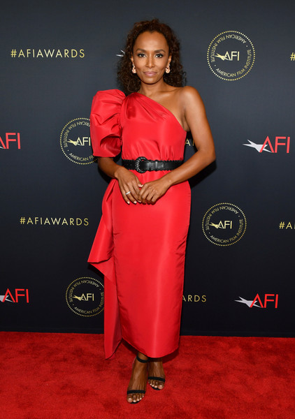 Janet Mock looked vibrant in a scarlet one-shoulder dress by Carolina Herrera at the 2020 AFI Awards.