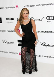 Adrienne Maloof showed a hint of sexiness at the Elton John Oscar party with this black evening dress featuring a sheer lace-panel skirt.