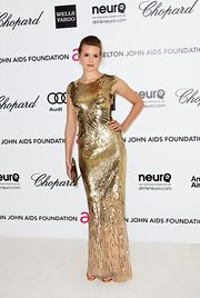Maggie Grace was saturated in gold sequins at Elton John's Oscar viewing party.