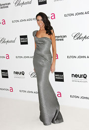 Terri Seymour wore this structured metallic gown to the Elton John Oscar viewing party.