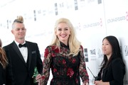 Singers Gwen Stefani (C) and Adrian Young arrive at the 20th Annual Elton John AIDS Foundation's Oscar Viewing Party held at West Hollywood Park on February 26, 2012 in West Hollywood, California.