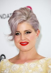 Kelly Osbourne wore her hair in a textured French twist with long side-swept bangs at the Elton John Oscar viewing party.