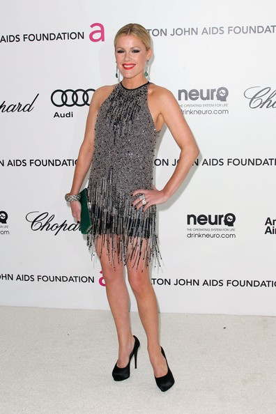 Kathleen Robertson accessorized her flapper-inspired mini dress with black satin peep-toe pumps.