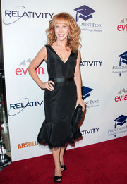 Kathy Griffin completed her red carpet look with a pair of black feather-embellished peep-toes.