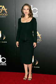 Natalie Portman complemented her dress with black slingback heels by Jimmy Choo.