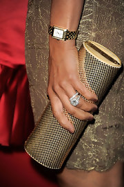 Eva la Rue shimmered in her all-gold ensemble at the Night at Sardi's event, topped off with this elegant watch and tube clutch.
