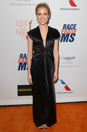 Kristin Cavallari's sleek black satin gown with a ruched waist looked super sexy on the star.