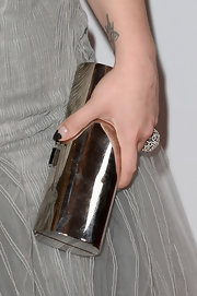 Kelly Osbourne showed off her hardware with this silver cylindrical clutch.