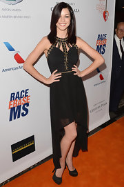 Alexis Knapp's black fishtail dress looked super cool and edgy with gold studded neck straps.