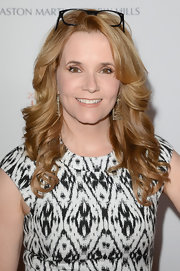 Lea Thompson opted for big and thick curls for her beauty look at the Love to Erase MS gala in California.