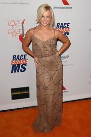 Chelsie Hightower chose a brown beaded gown with a cinched waist for her look at the Love to Erase MS gala.