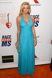 Camille Grammer chose a sky blue halter for her look at the Love to Erase MS gala in California.