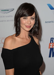 Catherine Bell's chocolate hair looked super stylish with a wavy 'do and side swept bangs.