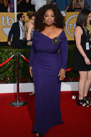 Oprah Winfrey looked voluptuous in a body-con blue off-the-shoulder gown by Badgley Mischka during the SAG Awards.