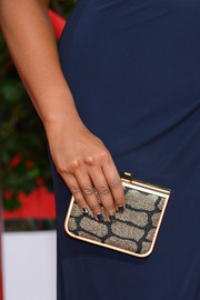 Mindy Kaling attended the 2014 SAG Awards carrying an elegant gold and black clutch by Jerome C. Rousseau.