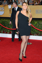 Mariah Carey showed off her voluptuous physique at the SAG Awards in a tight-fitting one-shoulder LBD by Saint Laurent.