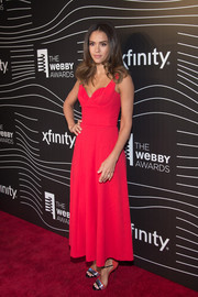 Jessica Alba paired her dress with red, black, and silver evening sandals by Casadei.