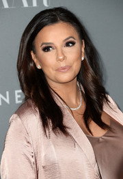 Eva Longoria kept it fuss-free with this loose center-parted hairstyle at the Costume Designers Guild Awards.