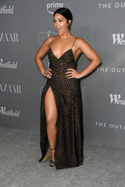 Gina Rodriguez ravished in a low-cut, high-slit, beaded slip gown by Rachel Sage Kunin at the Costume Designers Guild Awards.
