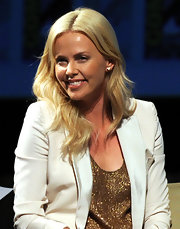 Charlize Theron dazzled at Comic Con in a sequined tank and a cream blazer. She finished off the look with wavy sun-kissed locks and a golden tan.