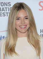 Sienna Miller's hair always looks flawless. We loved her center-parted 'do at the Hamptons Film Festival.