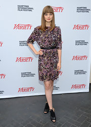 Bella Heathcote styled her abstract-printed shift with sleek black cutout peep-toe booties.