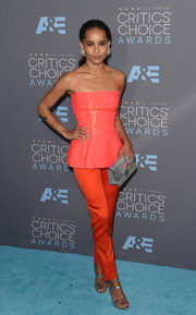 Zoe Kravitz styled her Dior separates with strappy silver sandals by Sophia Webster.