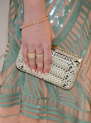 Leven Rambin accessorized her look with a gold, wide band ring with white diamonds while attending an Oscar party.