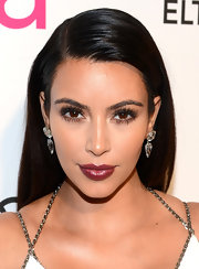 Kim Kardashian wore her raven locks side-parted and super-sleek to Elton John's 2013 Oscars after-party.