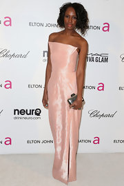 Catherine Kallon looked pretty in pink at the Elton John Oscar party with this pink column-style gown.